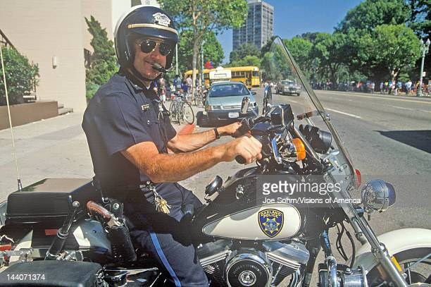 Oakland policeman poses on his motorcycle in Oakland California