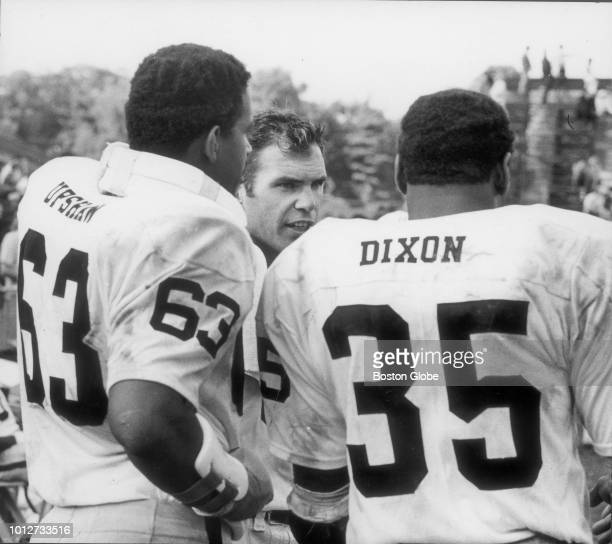 Oakland Radiers quarterback Daryle Lamonica talks to teammates during a game against the Boston Patriots at Alumni Stadium in Chestnut Hill Mass on...