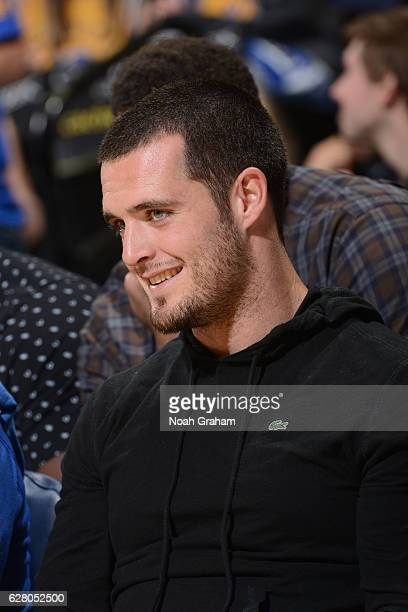 Oakland Raider Derek Carr attends the Indiana Pacers game against the Golden State Warriors on December 5 2016 at ORACLE Arena in Oakland California...