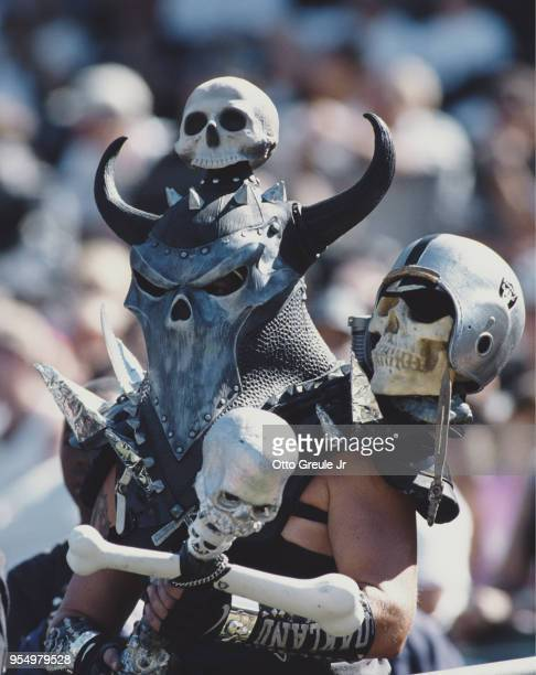 Oakland Raider fan complete with make up mask and skulls supports his team during the American Football Conference West game against the New Orleans...