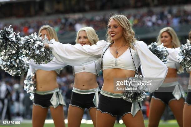 Oakland Raiders cheerleaders dance during the first half against the New England Patriots at Estadio Azteca on November 19 2017 in Mexico City Mexico