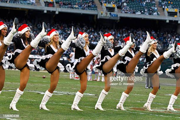 Oakland Raiders cheerleaders perform during the third quarter against the Kansas City Chiefs at Oco Coliseum on December 16 2012 in Oakland...