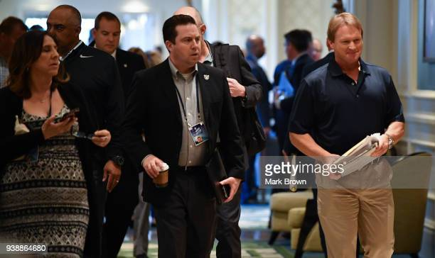 Oakland Raiders coach Jon Gruden breaks from the conference room at the 2018 NFL Annual Meetings at the Ritz Carlton Orlando Great Lakes on March 27...