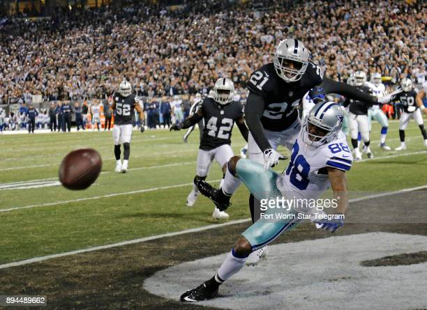 Oakland Raiders cornerback Sean Smith is called for pass interference on Dallas Cowboys wide receiver Dez Bryant in the second quarter setting up a...