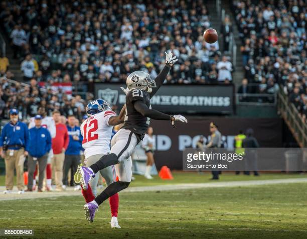 Oakland Raiders cornerback Sean Smith reaches for the ball against the New York Giants wide receiver Tavarres King on Sunday Dec 3 2017 at the...
