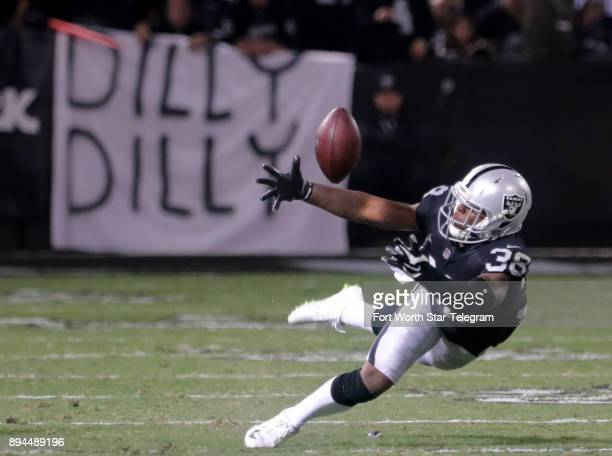 Oakland Raiders cornerback TJ Carrie almost has an interception as he breaks up a pass in the second quarter against the Dallas Cowboys on Sunday Dec...