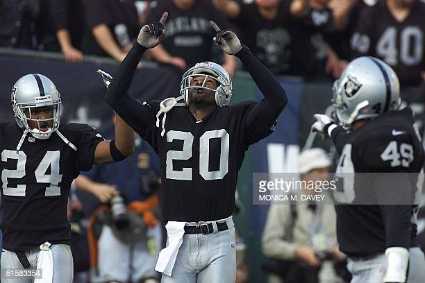 Oakland Raiders' cornerback Tory James celebrates after making an interception against the Miami Dolphins during the fourth quarter 06 January 2000...
