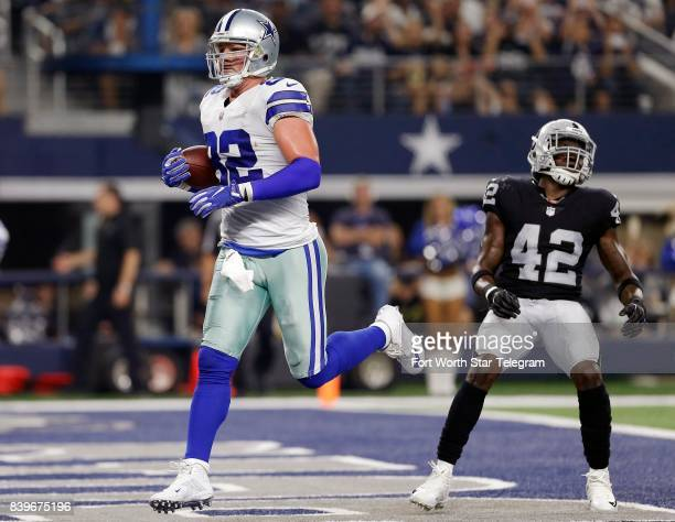 Oakland Raiders defensive back Karl Joseph looks on as Dallas Cowboys tight end Jason Witten scores a touchdown during the first half at ATT Stadium...