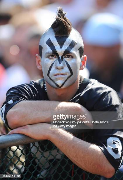 Oakland Raiders fan Brandon Hagan of San Ramon shows his disappointment as the Raiders trail the Denver Broncos in the fourth quarter on Sunday Sept...