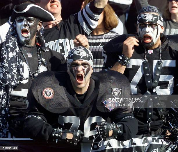 Oakland Raiders fans cheer in the stands during their AFC Championship game against the Baltimore Ravens in the first quarter 14 January at the...