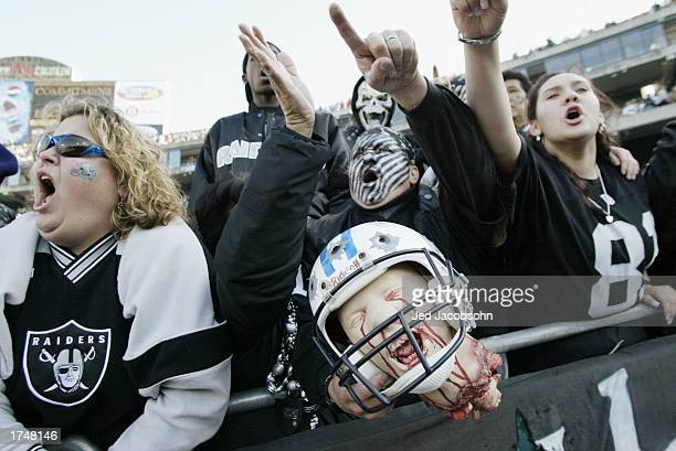 Oakland Raiders fans hold up a Titans head prior to the AFC Championship game against the Tennessee Titans at Network Associates Coliseum on January...
