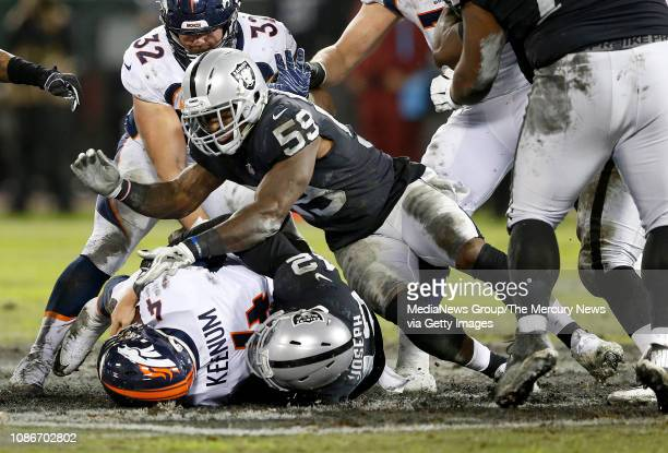 Oakland Raiders free safety Karl Joseph and outside linebacker Tahir Whitehead sack Denver Broncos' quarterback Case Keenum in the second quarter of...