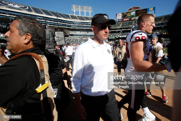 Oakland Raiders head coach Dennis Allen leaves the field after their NFL game against the Houston Texans at Oco Coliseum in Oakland Calif on Sunday...