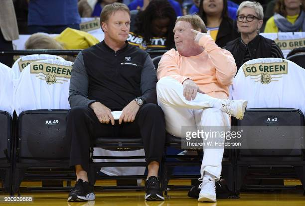 Oakland Raiders head coach John Gruden and Raiders owner Mark Davis at courtside watching an NBA basketball game between the San Antonio Spurs and...