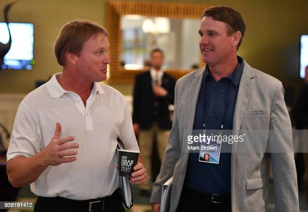 Oakland Raiders head coach Jon Gruden and brother and Washington Redskins head coach Jay Gruden attend the 2018 NFL Annual Meetings at the Ritz...