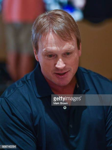 Oakland Raiders head coach Jon Gruden answers questions during the AFC NFC coaches breakfast at the 2018 NFL Annual Meetings at the Ritz Carlton...