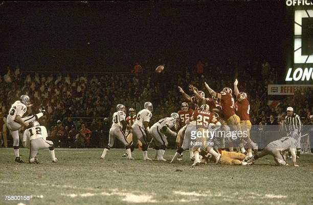 Oakland Raiders kicker George Blanda inducted into the Pro Football Hall of Fame class of 1981 kicks the gamewinning kick in overtime during a 2623...
