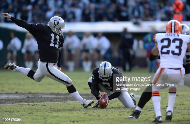 Oakland Raiders kicker Sebastian Janikowski kicks a 51yard field goal against the Cleveland Brown in the second quarter of their game at Oco Coliseum...