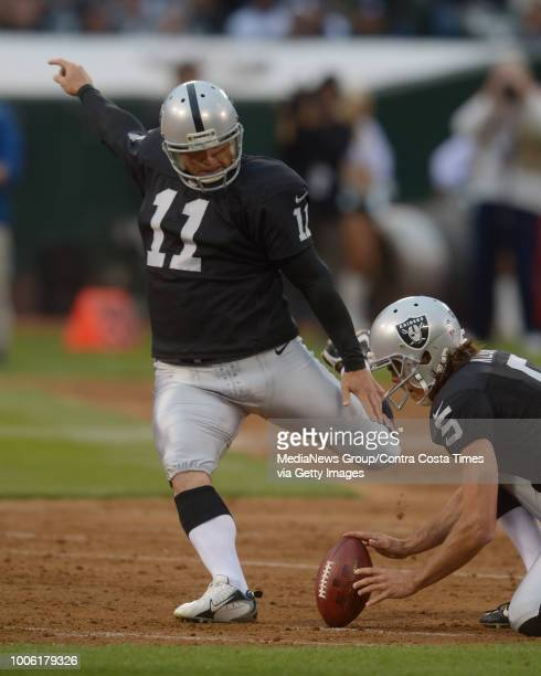 Oakland Raiders kicker Sebastian Janikowski kicks a 51yard field goal against the Dallas Cowboys in the first quarter of their preseason game at Oco...