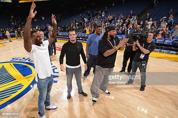 Oakland Raiders Latavious Murray Derek Carr and Donald Penn shoot around after the Indiana Pacers game against the Golden State Warriors on December...