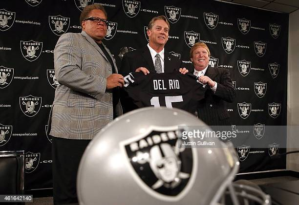 Oakland Raiders new head coach Jack Del Rio holds a jersey as he poses for a photograph with Raiders general manager Reggie McKenzie and Raiders...
