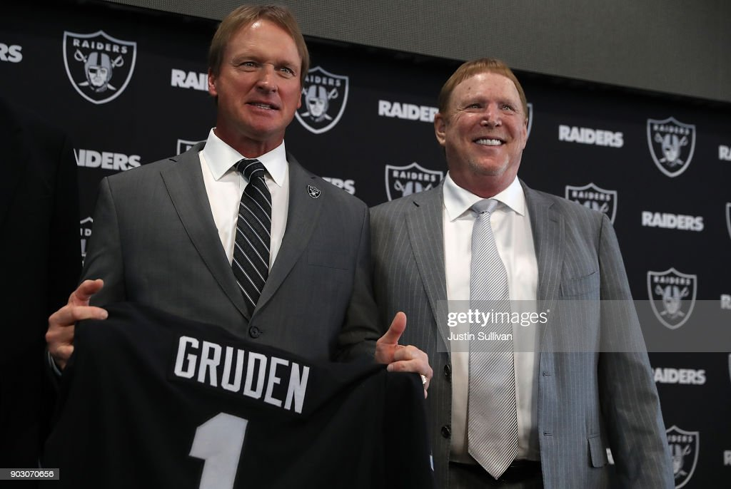 Oakland Raiders new head coach Jon Gruden (L) and Raiders owner Mark Davis pose for a photograph during a news conference at Oakland Raiders headquarters on January 9, 2018 in Alameda, California. Jon Gruden has returned to the Oakland Raiders after leaving the team in 2001.