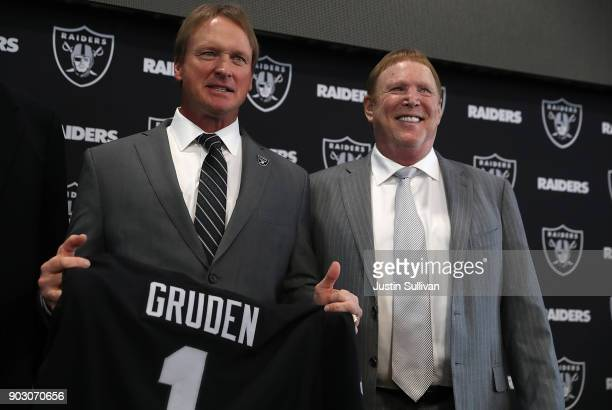 Oakland Raiders new head coach Jon Gruden and Raiders owner Mark Davis pose for a photograph during a news conference at Oakland Raiders headquarters...