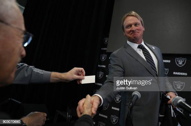 Oakland Raiders new head coach Jon Gruden greets reporters during a news conference at Oakland Raiders headquarters on January 9 2018 in Alameda...