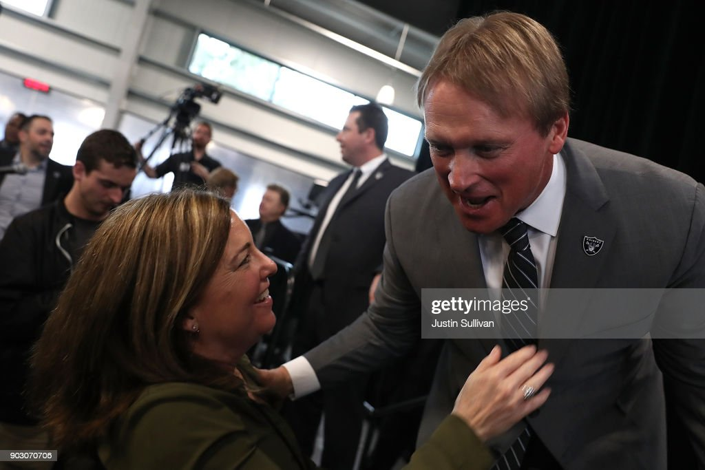 Oakland Raiders new head coach Jon Gruden (R) greets San Francisco Chronicle sports reporter Ann Killion (L) during a news conference at Oakland Raiders headquarters on January 9, 2018 in Alameda, California. Jon Gruden has returned to the Oakland Raiders after leaving the team in 2001.