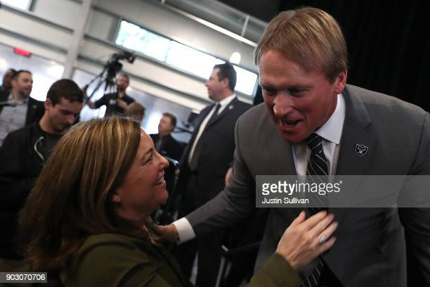 Oakland Raiders new head coach Jon Gruden greets San Francisco Chronicle sports reporter Ann Killion during a news conference at Oakland Raiders...
