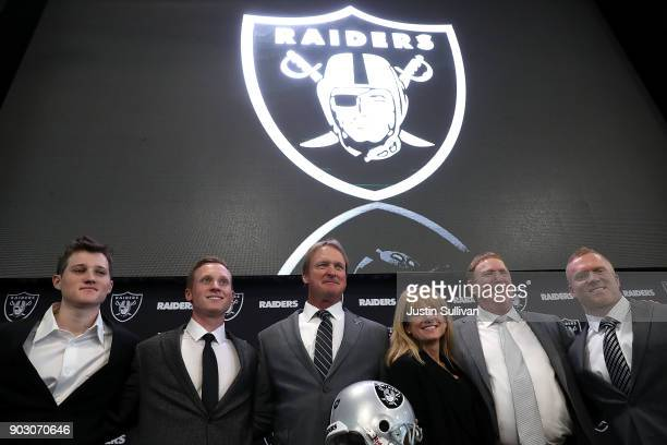 Oakland Raiders new head coach Jon Gruden poses for a photo with members of his family during a news conference at Oakland Raiders headquarters on...