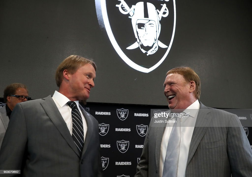 Oakland Raiders new head coach Jon Gruden (L) talks with Raiders owner Mark Davis during a news conference at Oakland Raiders headquarters on January 9, 2018 in Alameda, California. Jon Gruden has returned to the Oakland Raiders after leaving the team in 2001.