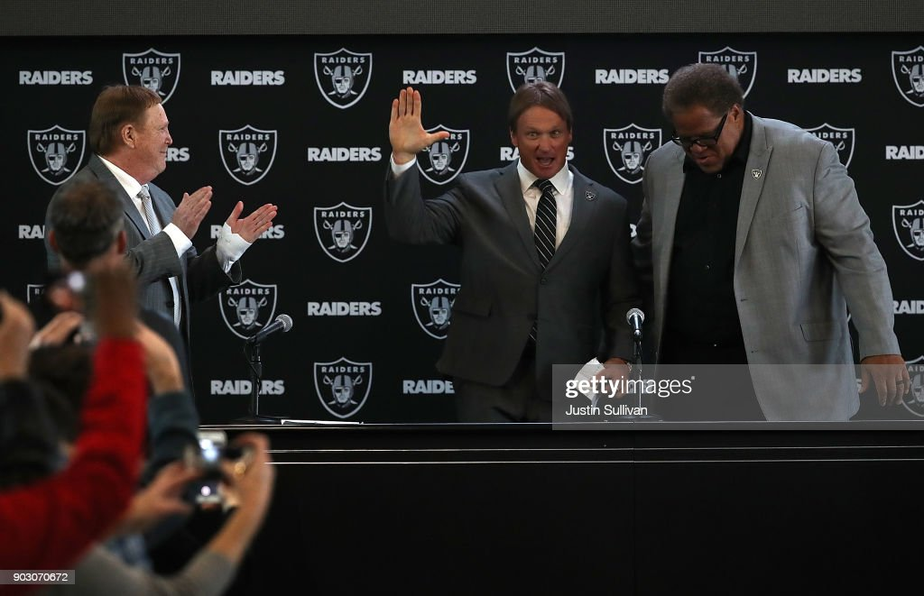 Oakland Raiders new head coach Jon Gruden (C) waves to attendees during a news conference at Oakland Raiders headquarters on January 9, 2018 in Alameda, California. Jon Gruden has returned to the Oakland Raiders after leaving the team in 2001.