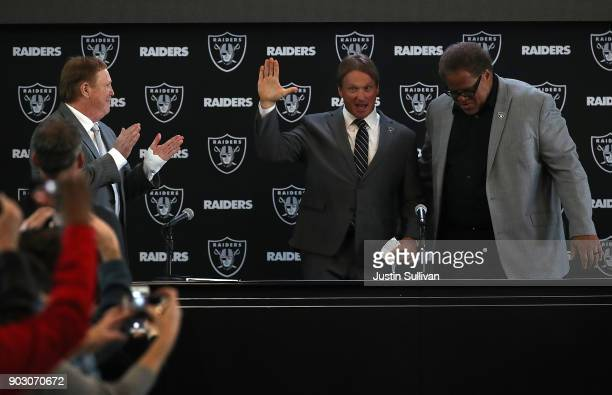 Oakland Raiders new head coach Jon Gruden waves to attendees during a news conference at Oakland Raiders headquarters on January 9 2018 in Alameda...