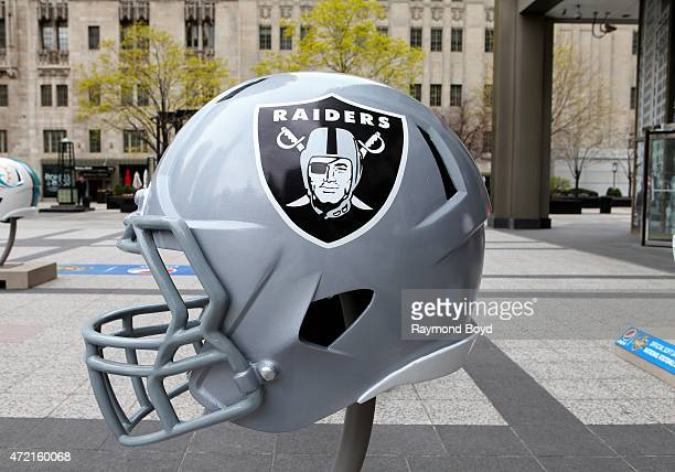 Oakland Raiders NFL football helmet is on display in Pioneer Court to commemorate the NFL Draft 2015 in Chicago on April 30 2015 in Chicago Illinois
