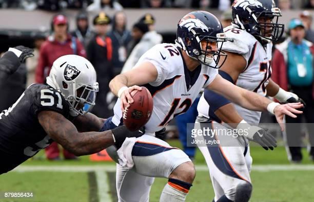 Oakland Raiders outside linebacker Bruce Irvin sacks Denver Broncos quarterback Paxton Lynch during the second quarter on November 26 2017 in Oakland...