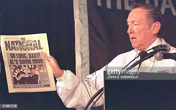 Oakland Raiders owner Al Davis holds up a 1990 copy of The National a sports newspaper now out of business during a press conference at the Oakland...