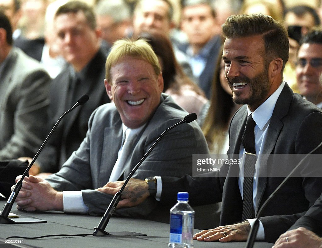 Oakland Raiders owner Mark Davis (L) and former soccer player David Beckham laugh as they attend a Southern Nevada Tourism Infrastructure Committee meeting at UNLV on April 28, 2016 in Las Vegas, Nevada. Davis told the committee he is willing to spend USD 500 million as part of a deal to move the team to Las Vegas if a proposed USD 1.3 billion, 65,000-seat domed stadium is built by casino magnate Sheldon Adelson's Las Vegas Sands Corp. and real estate agency Majestic Realty, possibly on a vacant 42-acre lot a few blocks east of the Las Vegas Strip recently purchased by UNLV.