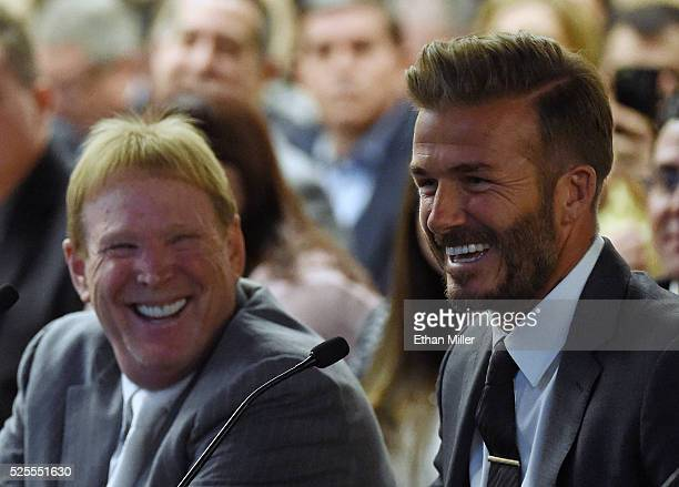 Oakland Raiders owner Mark Davis and former soccer player David Beckham laugh as they attend a Southern Nevada Tourism Infrastructure Committee...