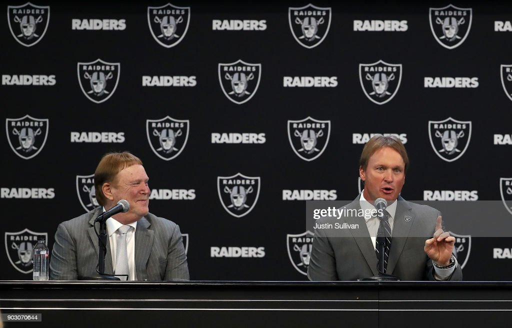 Oakland Raiders owner Mark Davis (L) looks on as Oakland Raiders new head coach Jon Gruden (R) speaks during a news conference at Oakland Raiders headquarters on January 9, 2018 in Alameda, California. Jon Gruden has returned to the Oakland Raiders after leaving the team in 2001.