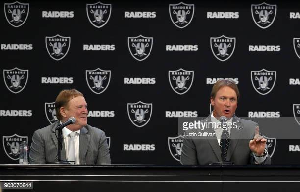 Oakland Raiders owner Mark Davis looks on as Oakland Raiders new head coach Jon Gruden speaks during a news conference at Oakland Raiders...