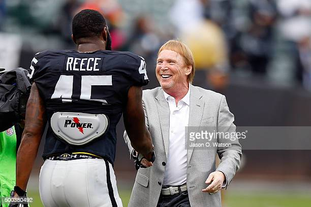 Oakland Raiders owner Mark Davis shakes hands with Marcel Reece on the field before the game against the Kansas City Chiefs at Oco Coliseum on...