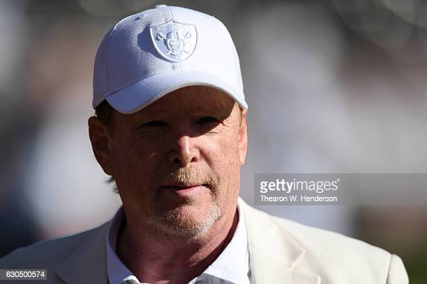 Oakland Raiders owner Mark Davis stands on the field prior to their NFL game against the Indianapolis Colts at Oakland Alameda Coliseum on December...