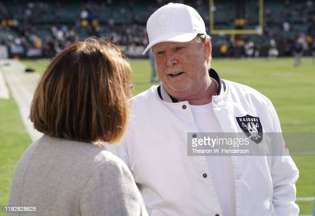 Oakland Raiders owner Mark Davis talks with the Tennessee Titans owner Amy Adams Strunk prior to the start of an NFL football game at RingCentral...