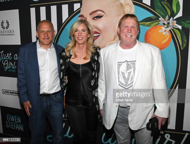Oakland Raiders President Marc Badain his wife Amy Badain and Raiders owner Mark Davis attend the grand opening of the Gwen Stefani Just a Girl...