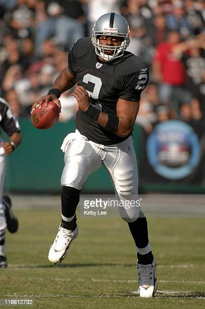 Oakland Raiders quarterback Aaron Brooks scrambles during 2314 loss to the Houston Texans at McAfee Coliseum in Oakland Calif on Sunday December 4...