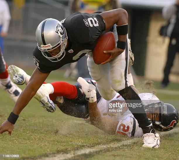 Oakland Raiders quarterback Aaron Brooks tries to elude Glenn Earl of the Houston Texans in the fourth quarter of 2314 loss to the Texans at McAfee...