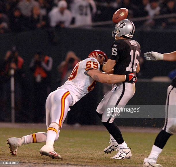 Oakland Raiders quarterback Andrew Walter fumbles after being hit by Kansas City Chiefs defensive end Jared Allen during NFL Network game at McAfee...