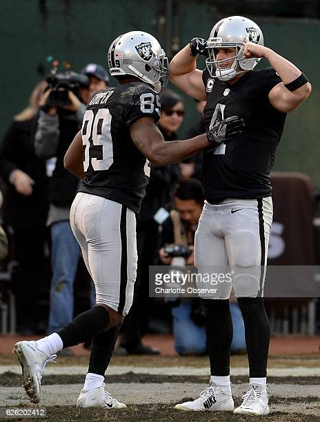 Oakland Raiders quarterback Derek Carr flexes his muscles after throwing a twopoint conversion pass to wide receiver Seth Roberts during fourth...