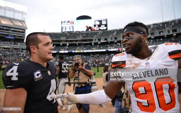 Oakland Raiders Quarterback Derek Carr in conversation with Cleveland Browns Defensive End Emmanuel Ogbah after their overtime NFL football game...